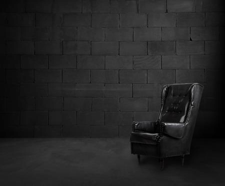 empty room: Black brick room interior design with armchair