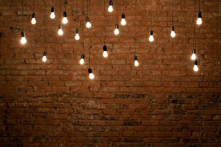 wall light: Light bulbs over brick wall texture