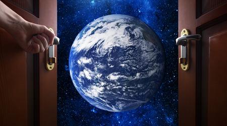 opens: hand opens room door to galaxy