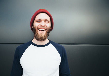 Hipster man smiling and wearing white blank t-shirt
