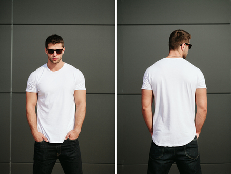 posing: Man wearing white blank t-shirt with space for your logo