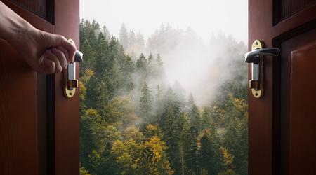 opens: hand opens room door to the nature Stock Photo