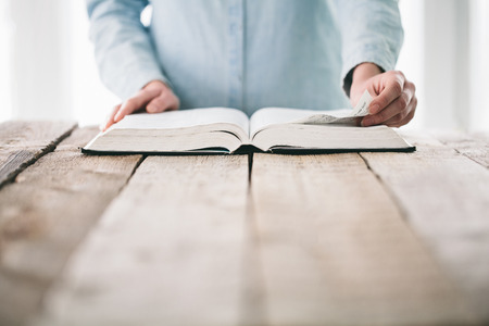 turning page: Hands turning the page of a bible Stock Photo
