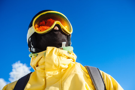 skying: Snowboarder looking ahead Stock Photo