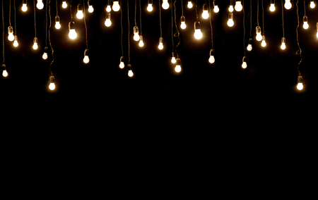 lightings: Light bulbs over dark texture Stock Photo