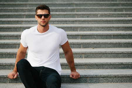 Man wearing white blank t-shirt with space for your logo