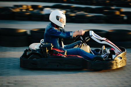 Karting competition or racing cars riding for victory on a racetrack 版權商用圖片 - 85282834