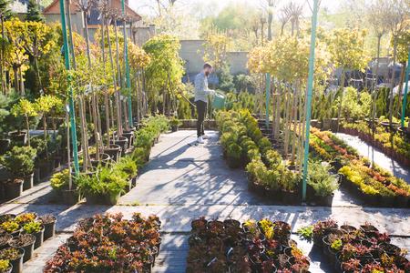 Hipster gardener working in the garden in the city