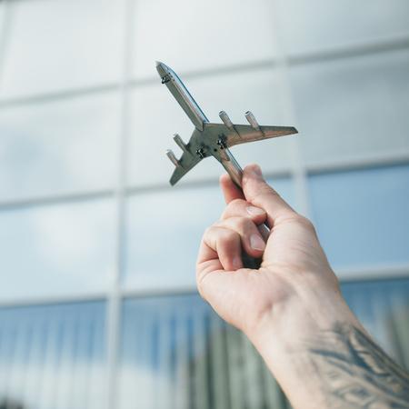 Hand holding metal airplane