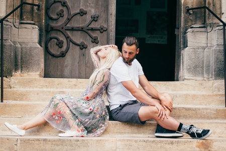 Couple in love relaxing and sitting on the city streets Stock Photo