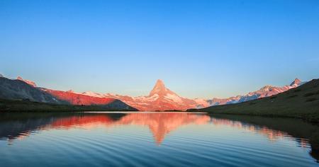 Matterhorn Mountain with white snow and blue sky in Zermatt city in Switzerland