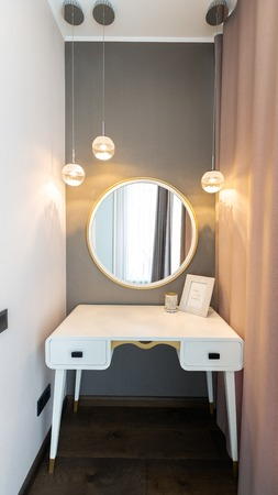 Console-mirror for make up in modern room