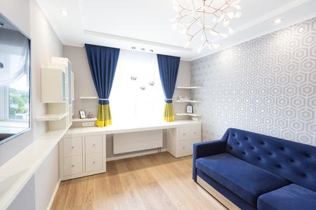 Modern living room interior design with blue sofa and a big window