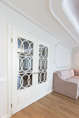 Modern white doors in a room interior Stock Photo