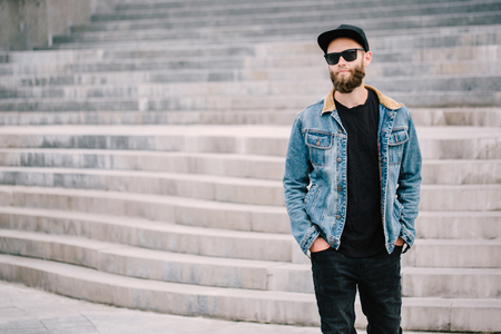 Hipster handsome male model with beard wearing black blank t-shirt