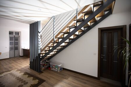 Wooden stairway in the house interior with stair light Stock fotó