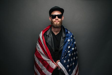 Patriot hipster man holding emotionally american USA flag