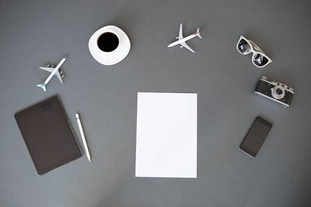 White sheet of paper for your text. Overhead view with travel items around it Reklamní fotografie