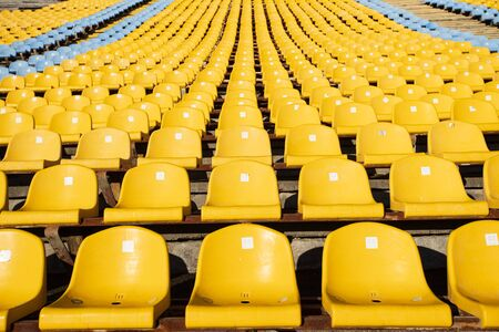 Soccer yellow football seat in a row