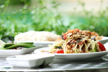 Thai green papaya salad add crab. photo
