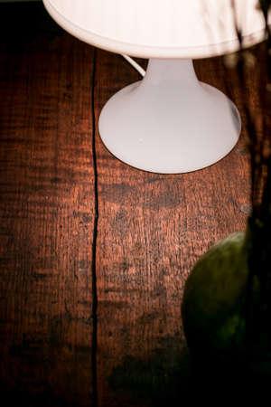 old desk: Table lamp on the old desk in dark room.