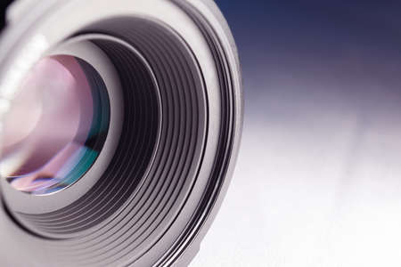camera lens close-up on a white-blue gradient background
