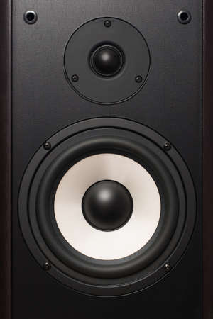 front of the audio speaker, with a white round speaker Stock Photo