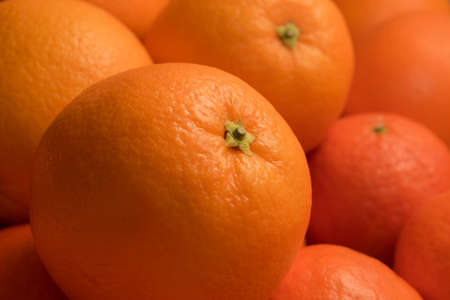 a lot of fresh bright oranges close up