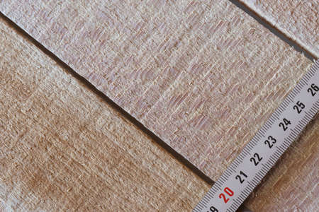 Measuring tape of roulette on wooden boards close-up