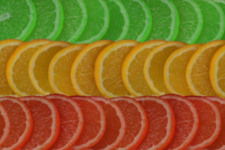 background of sliced citrus red, yellow and green