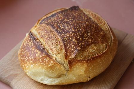 A loaf of Italian bread on cutting board