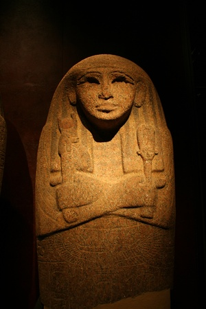 Ancient Egyptian sculpture in the dark background photo