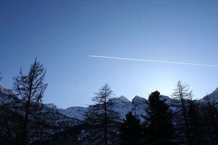 Airplane Above the Mountains Stock Photo - 12632461