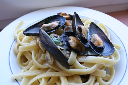 Pasta with seafood cooked with onion and parsley photo