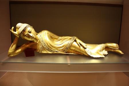 Asian statue, recline buddha image photo