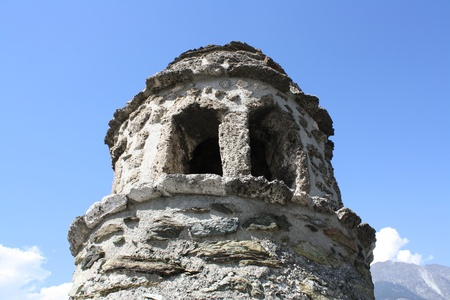 impervious: Picture of a chimney from an ancient castle set against a blue, Ussel castle  Aosta Italy  Editorial