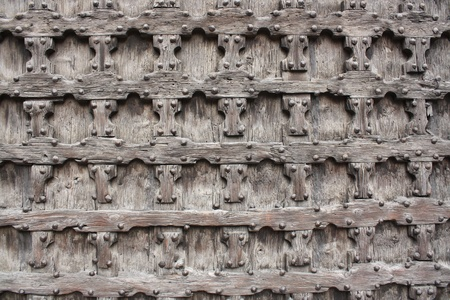 A ancient wooden door detail   Italy  photo