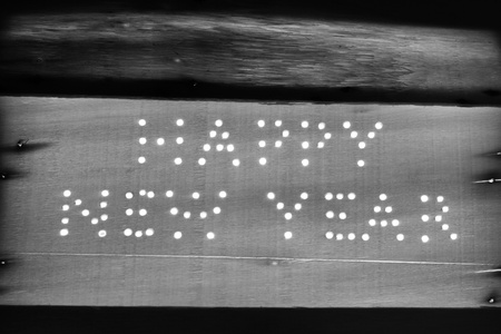 Black and white picture of Happy New Year logo on a wooden board photo