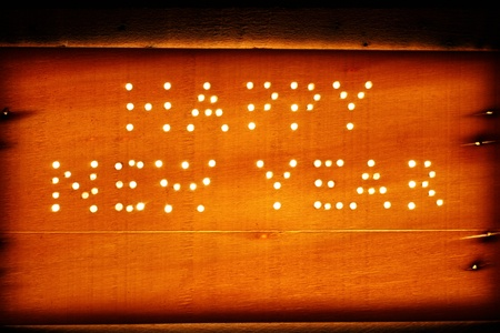 Happy New Year logo on a wooden board photo