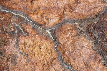 mottle: Macro immagine di texture vecchio invecchiato pietra rossa