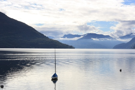 A lonely boat on Lake Maggiore   Italy   photo