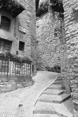 Small medieval city alley in Assisi Umbria Italy
