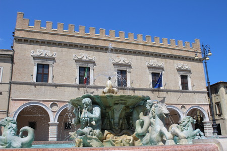View of the Maggiore Fountain in the square of the people, with Palazzo Ducale as background (Pesaro, Marche, Italy)