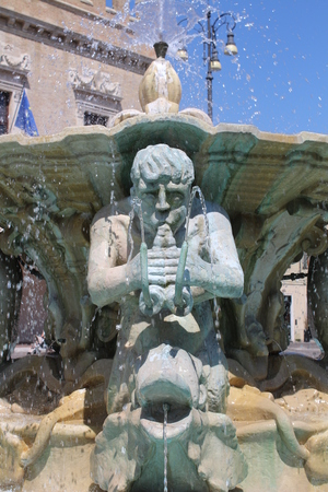 View of the Maggiore Fountain in the square of the people (Pesaro, Marche, Italy) Stock Photo
