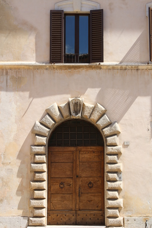 The entrance door to an old Italian house Stock Photo