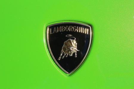 MARANELLO, ITALY - AUGUST 24, 2016: Classic Lamborghini logo on a green car body