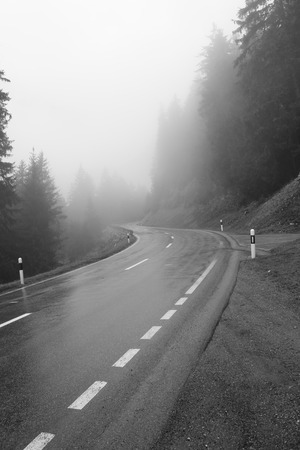 Country road with fog and rain