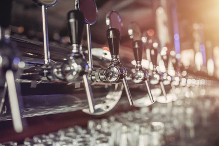 Shiny silver beer taps in pub Stok Fotoğraf - 80942780