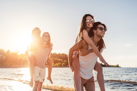 Group of young friends are having fun on beach. Stock Photo
