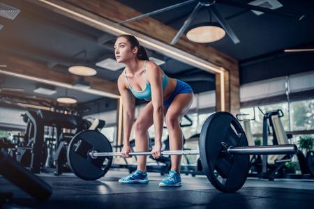 Attractive young sports woman with barbell. Deadlift. Lizenzfreie Bilder